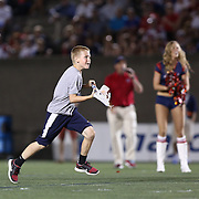 A young fan of the Boston Cannons takes part in a competition during a break in the game at Harvard Stadium on August 9, 2014 in Boston, Massachusetts. (Photo by Elan Kawesch)