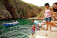Mark Kosenchuk, 9 gives a big laugh with Alfredo after a small boat turn upside down with the excessive weight of 4 men, at Berlengas Island. It was the first time he stepped on a boat.
