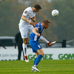 Dovers defender Connor Essam wins th eball over Salford's forward Adam Rooney during the National League match between Dover Athletic FC and Salford City FC at Crabble Stadium, Kent on 06 October 2018. Photo by Matt Bristow.