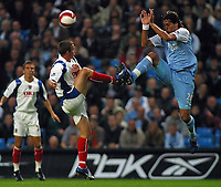 Photo: Paul Thomas.<br /> Manchester City v Portsmouth. The Barclays Premiership. 23/08/2006.<br /> <br /> Georgios Samaras of Man City (R) jumps into Shaun Davis to win the ball.