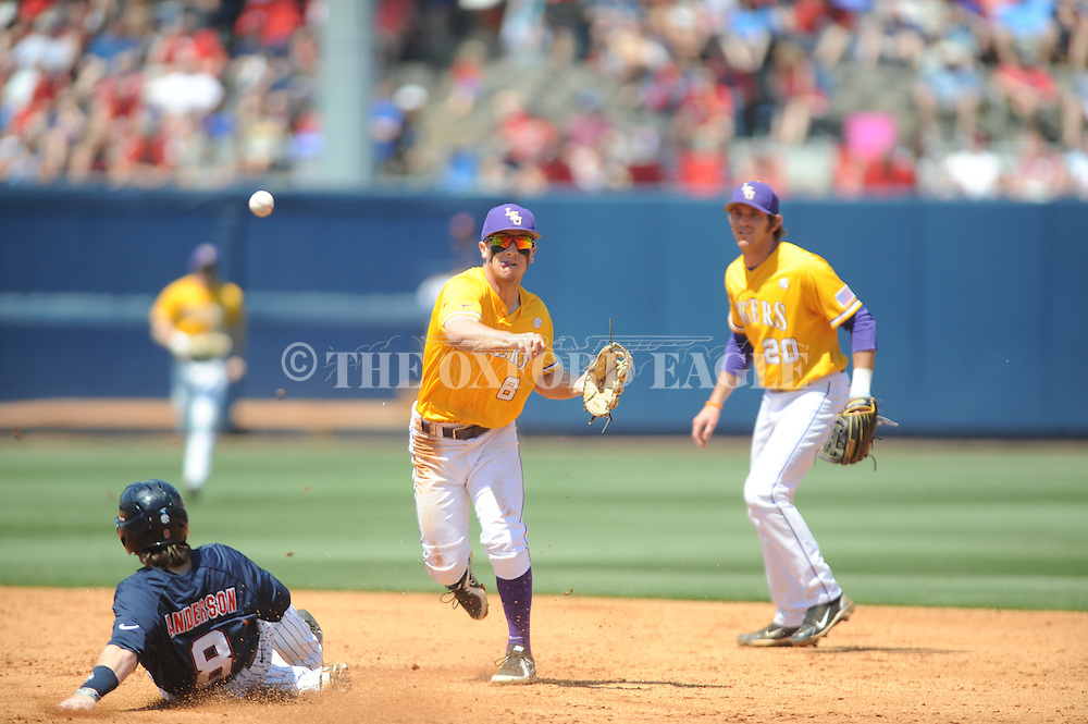LSU shortstop Alex Bregman (8) forces out Mississippi's Austin Anderson (8) on a double play at Oxford-University Stadium in Oxford, Miss. on Saturday, April 19, 2014. (AP Photo/Oxford Eagle, Bruce Newman)