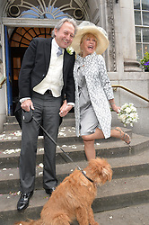 PATTIE BOYD and ROD WESTON photographed at their wedding with their dog Freddie at Chelsea Registry Office, Chelsea Old Town Hall, King's Road, London on 30th April 2015.  Pattie Boyd was previously married to both George Harrison and Eric Clapton.