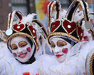 PHILADELPHIA - JANUARY 6:  Veronica Pezzeca (L) and Kim Malcolm of the Trilby String Band wait to perform during the 2007 Mummers Parade January 6, 2007 in Philadelphia, Pennsylvania. Thousands came to watch the Mummers Parade, which was postponed from New Years Day due to rain. Temperatures in the Philadelphia region were record highs in the low 70's. (Photo by William Thomas Cain/Getty Images)