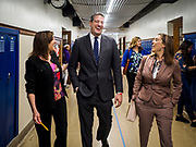"""08 APRIL 2019 - DES MOINES, IOWA: Rep. TIM RYAN (center) and his wife, ANDREA RYAN (right), walk through the halls with a school administrator at Callanan Middle School. Ryan, a candidate for the Democratic ticket of the US presidency, visited Callanan Middle School in Des Moines to discuss education issues. Ryan declared his candidacy on the US television show """"The View"""" on April 4. Ryan, 45 years old, represents Ohio's 13th District, which includes Lordstown, where a large General Motors plant recently closed. He is the latest Democrat to announce his candidacy to be the Democratic nominee in the 2020 election. Iowa holds its presidential caucuses on Feb. 3, 2020.       PHOTO BY JACK KURTZ"""