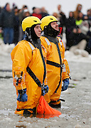 Safety personnel prepare for the 14th Annual Polar Bear Plunge at Ontario Beach Park on Sunday, February 9, 2014.
