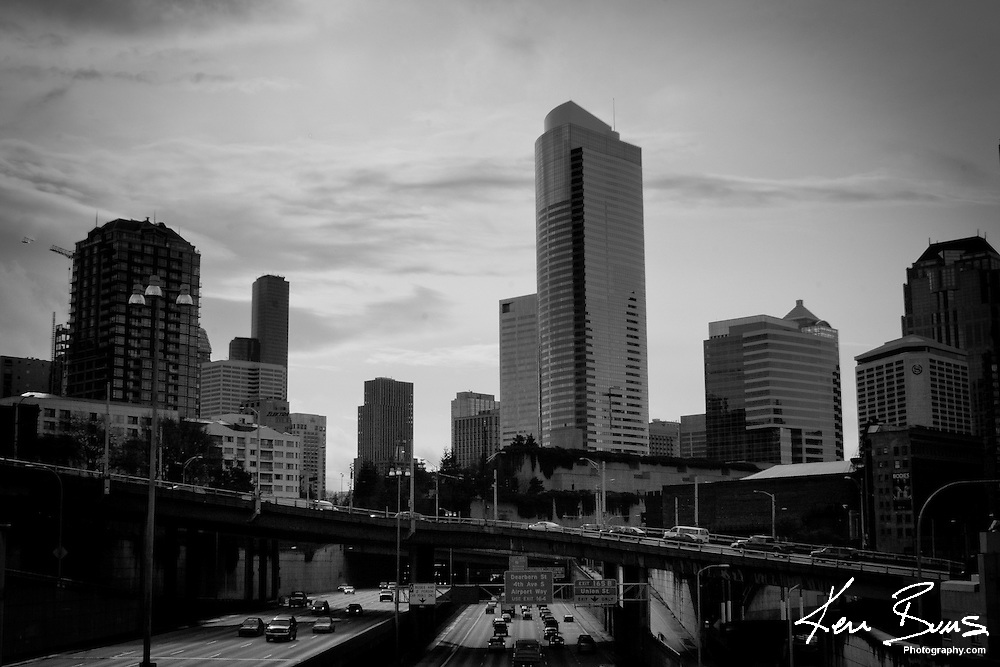 A Black and White image of the skyscrapers on Seattle's Horizon, from a bridge looking south onto Interstate 5.