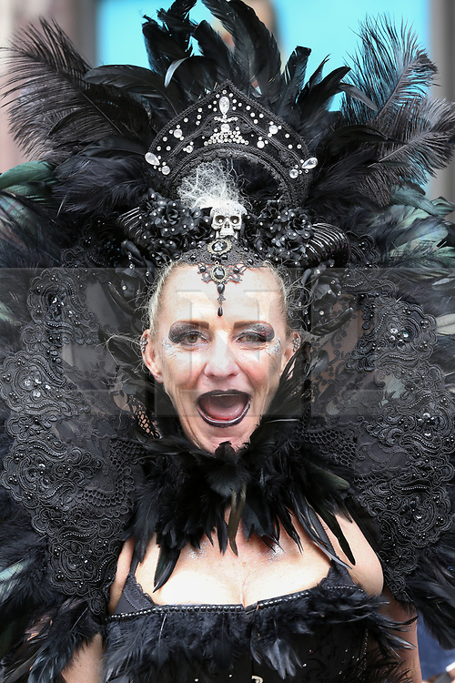 © Licensed to London News Pictures. 06/07/2019. London, UK. A participant with a black coloured feathers headdresses at the annual Pride Parade in central London. An estimated over 1 million people lined along the route in support of the LGBT (Lesbian, Gay, Bisexual and Transgender/Transsexual) community. Photo credit: Dinendra Haria/LNP
