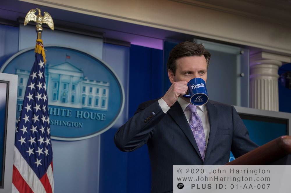 On opening day of Major League Baseball, White House Press Secretary Josh Earnest drinks from a Kansas City Royals mug during his daily briefing, Monday April 6th, 2015 in the White House Briefing Room. Earnest noted his preference for the Royals during the briefing.