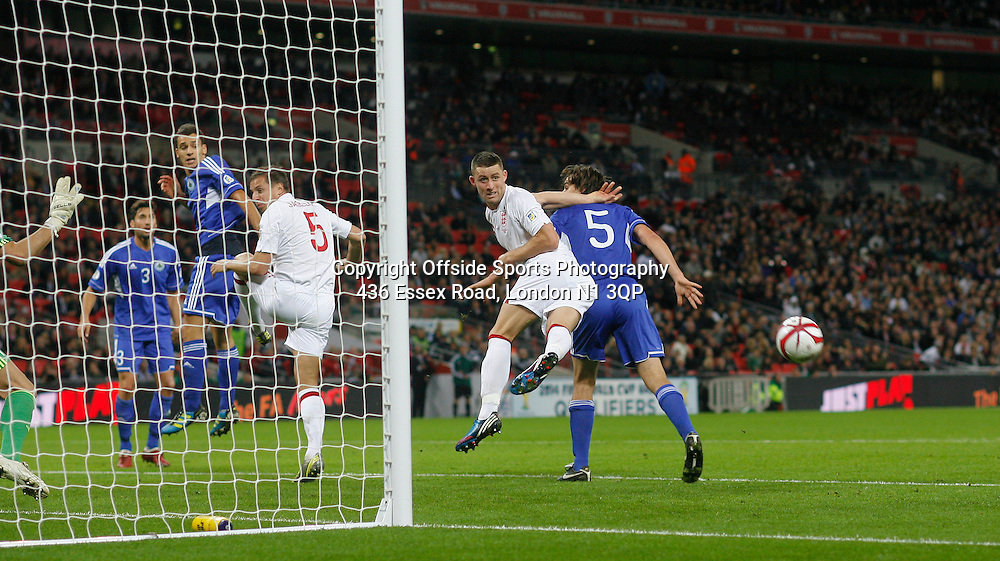 12 October 2012 Football International. England v San Marino.<br /> Gary Cahill heads wide from close range.