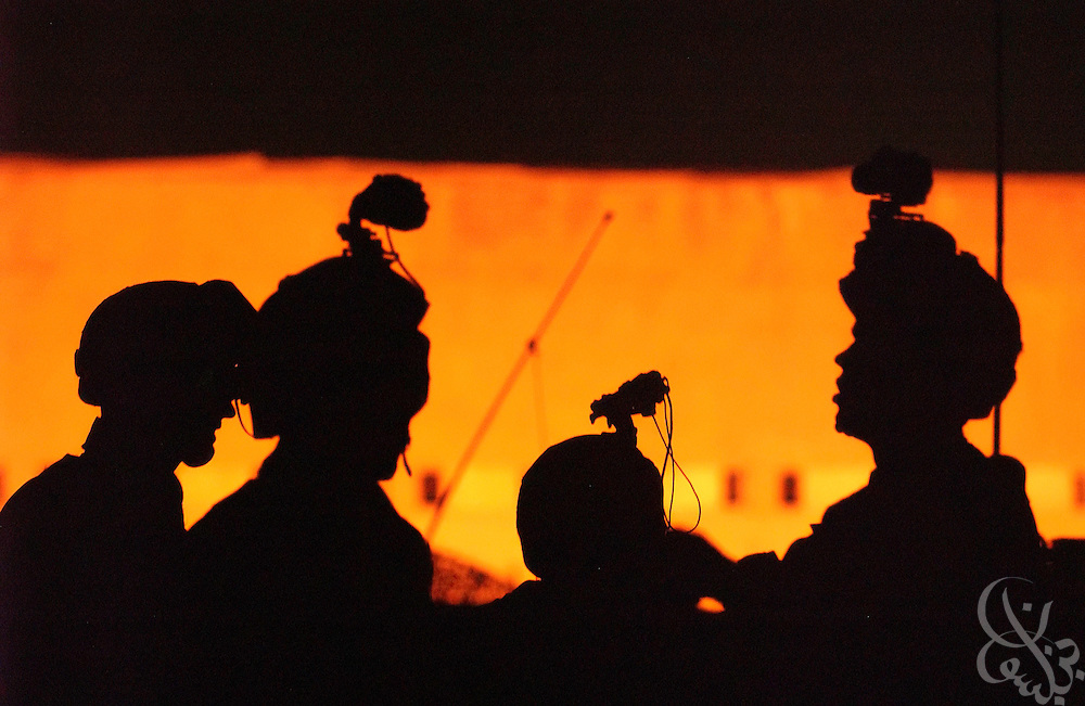 Soldiers with the U.S. Army 101st Airborne 3-502 are silhouetted as they head out on a nighttime mission July 27, 2003 in Mosul, Iraq.