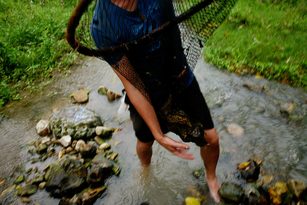 Kris checks his net for shrimp near the Río Muchacho Organic farm at Bahía de Caraquez, Ecuador.