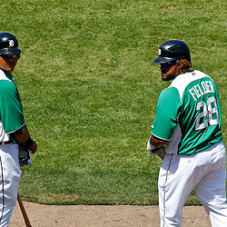 March 17, 2012; Lakeland, FL, USA; Detroit Tigers third baseman Miguel Cabrera (24) and first baseman Prince Fielder (28) wait to bat during the bottom of the fourth inning of a spring training game against the St. Louis Cardinals at Joker Marchant Stadium. Both teams wore green jerseys and the field was marked with shamrocks for the St. Patrick's Day game. Mandatory Credit: Derick E. Hingle-US PRESSWIRE