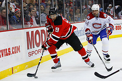 Jan 2, 2009; Newark, NJ, USA; New Jersey Devils left wing Zach Parise (9) skates away from Montreal Canadiens defenseman Roman Hamrlik (44) during the second period at the Prudential Center.