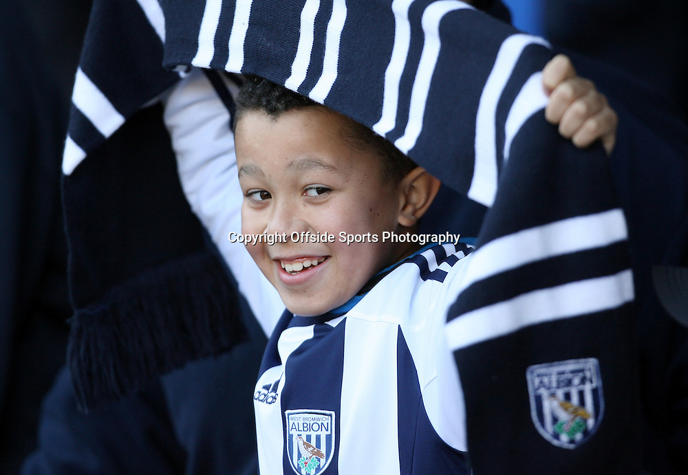 25/02/2012 - Barclays Premier League - West Bromwich Albion vs. Sunderland - A young West Brom fan holds up his scarf - Photo: Simon Stacpoole / Offside.