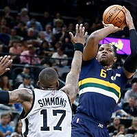 02 April 2017: Utah Jazz forward Joe Johnson (6) takes a jump shot over San Antonio Spurs guard Jonathon Simmons (17) during the San Antonio Spurs 109-103 victory over the Utah Jazz, at the AT&T Center, San Antonio, Texas, USA.