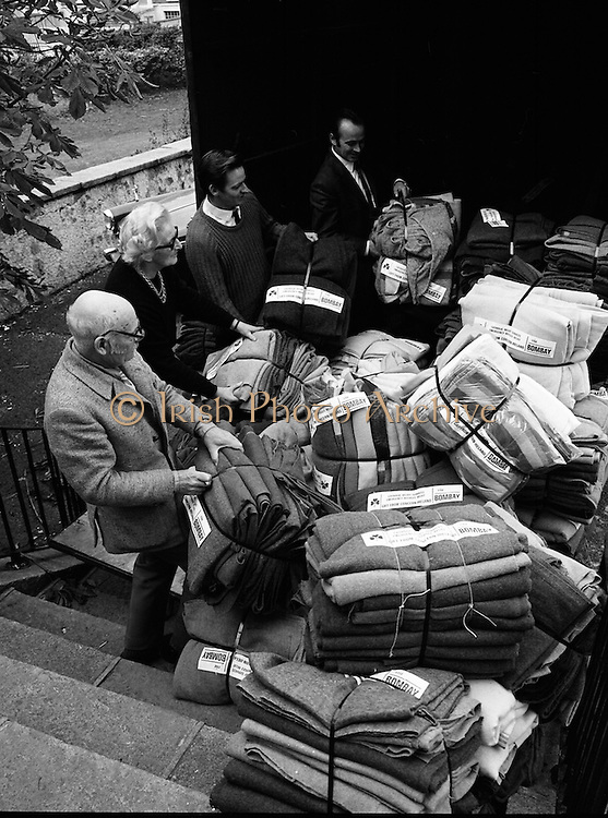 Africa Concern Loading Blankets.<br /> 1971.<br /> 11.11.1971.<br /> 11th November 1971.<br /> Africa Concern in response to a request from Christian Aid in London, collected and packed for delivery 350 blankets. The blankets were to be sent to Pakistan to help the relief work being carried out there. Aer Lingus, the national airline, graciously agreed to fly the blankets to London free of charge.<br /> <br /> Image shows the Africa Concern Volunteers packing the blankets for delivery to Dublin Airport. The blankets were donated by the public over a five day period.