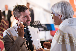 "16 May 2017, Windhoek, Namibia: Church of Sweden Archbishop Antje Jackelén received Holy Communion. As the Twelfth Assembly of the Lutheran World Federation is coming to an end, a closing worship service celebrates the LWF Communion and a successful Assembly, and installing the newly elected LWF Council and President. The Twelfth Assembly of the Lutheran World Federation gathers in Windhoek, Namibia, on 10-16 May 2017, under the theme ""Liberated by God's Grace"", bringing together some 800 delegates and participants from 145 member churches in 98 countries."