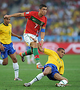 CRISTIANO RONALDO (li, Portugal) takes on DANI ALVES  during the 2010 FIFA World Cup South Africa Group G match between Portugal and Brazil at Durban Stadium on June 25, 2010 in Durban, South Africa.