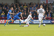 AFC Wimbledon midfielder Tom Soares (14) fouls Northampton Town midfielder Matthew Taylor (31) during the EFL Sky Bet League 1 match between AFC Wimbledon and Northampton Town at the Cherry Red Records Stadium, Kingston, England on 11 March 2017. Photo by Stuart Butcher.