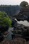 Pools line the edge of Victoria Falls fed from a low flowing Zambezi River.