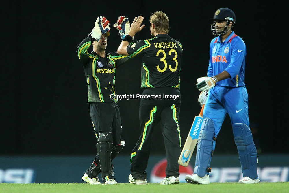 n56/ departs as Matthew Wade and Shane Watson celebrate his wicket during the ICC World Twenty20 Super 8s match between Australia and India held at the Premadasa Stadium in Colombo, Sri Lanka on the 28th September 2012<br /> <br /> Photo by Ron Gaunt/SPORTZPICS
