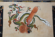 Penis and animal spirit paintings on the wall Bumthang, Bhuthan...Bhutan the country that prides itself on the development of 'Gross National Happiness' rather than GNP. This attitude pervades education, government, proclamations by royalty and politicians alike, and in the daily life of Bhutanese people. Strong adherence and respect for a royal family and Buddhism, mean the people generally follow what they are told and taught. There are of course contradictions between the modern and tradional world more often seen in urban rather than rural contexts. Phallic images of huge penises adorn the traditional homes, surrounded by animal spirits; Gross National Penis. Slow development, and fending off the modern world, television only introduced ten years ago, the lack of intrusive tourism, as tourists need to pay a daily minimum entry of $250, ecotourism for the rich, leaves a relatively unworldly populace, but with very high literacy, good health service and payments to peasants to not kill wild animals, or misuse forest, enables sustainable development and protects the country's natural heritage. Whilst various hydro-electric schemes, cash crops including apples, pull in import revenue, and Bhutan is helped with aid from the international community. Its population is only a meagre 700,000. Indian and Nepalese workers carry out the menial road and construction work.