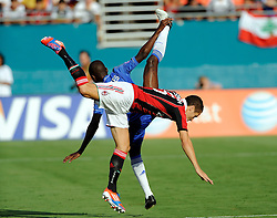 28 July 2012: Chelsea FC Ramires (7) and AC Milan Djamel Mesbah fight for control of the ball during the World Football Challenge as A.C. Milan defeated Chelsea FC 1-0 at Sun Life Stadium in Miami, FL.