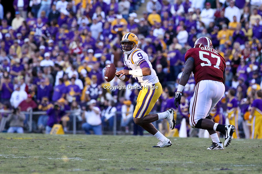 November 6, 2010; Baton Rouge, LA, USA;  LSU Tigers quarterback Jordan Jefferson (9) is pursued by Alabama Crimson Tide defensive tackle Marcell Dareus (57) during the second half at Tiger Stadium. LSU defeated Alabama 24-21.  Mandatory Credit: Derick E. Hingle