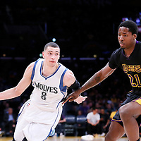10 April 2014: Minnesota Timberwolves guard Zach LaVine (8) drives past Los Angeles Lakers forward Ed Davis (21) during the Los Angeles Lakers 106-98 victory over the Minnesota Timberwolves, at the Staples Center, Los Angeles, California, USA.