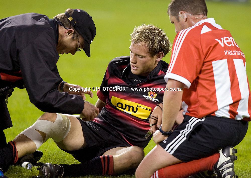 Andy Ellis has his Knee straped during the game with referee Bryce Lawrence watching on. Air NZ Cup, Semi-final. Canterbury v Hawkes Bay at AMI Stadium, Christchurch, New Zealand. 18 October 2008 Photo: Joseph Johnson/PHOTOSPORT