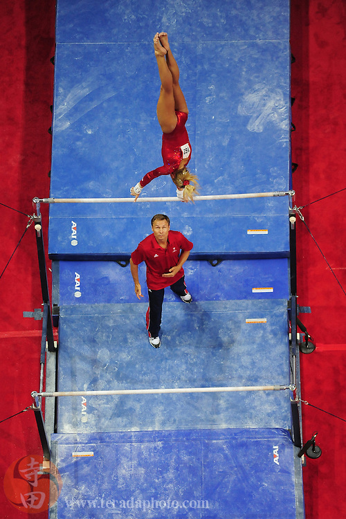 July 1, 2012; San Jose, CA, USA; Nastia Liukin (top) performs on the uneven bars as coach Valeri Liukin (bottom) spots during the 2012 USA Gymnastics Olympic Team Trials at HP Pavilion.