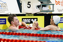 Adam Peaty is congratulated by teammate and runner up Ross Murdoch after winning Gold in the Mens 100m Breaststroke Final - Photo mandatory by-line: Rogan Thomson/JMP - 07966 386802 - 19/08/2014 - SPORT - SWIMMING - Berlin, Germany - Velodrom im Europa-Sportpark - 32nd LEN European Swimming Championships 2014 - Day 7.
