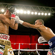 Jonathan Gonzalez (R) lands a shot the head of Richard Rodriguez during a Telemundo boxing match between at Osceola Heritage Park on Friday, February 23, 2018 in Kissimmee, Florida.  (Alex Menendez via AP)