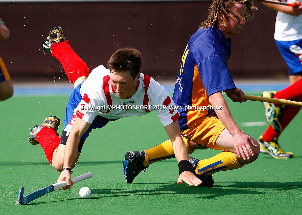 Auckland's Simon Child goes flying after being tackled by Southern's Nick Budgeon. Mens, Auckland v Southern. National Hockey League National Tournament, Porritt Park, Christchurch, New Zealand, Sunday 21 September. Photo: Simon Watts/PHOTOSPORT