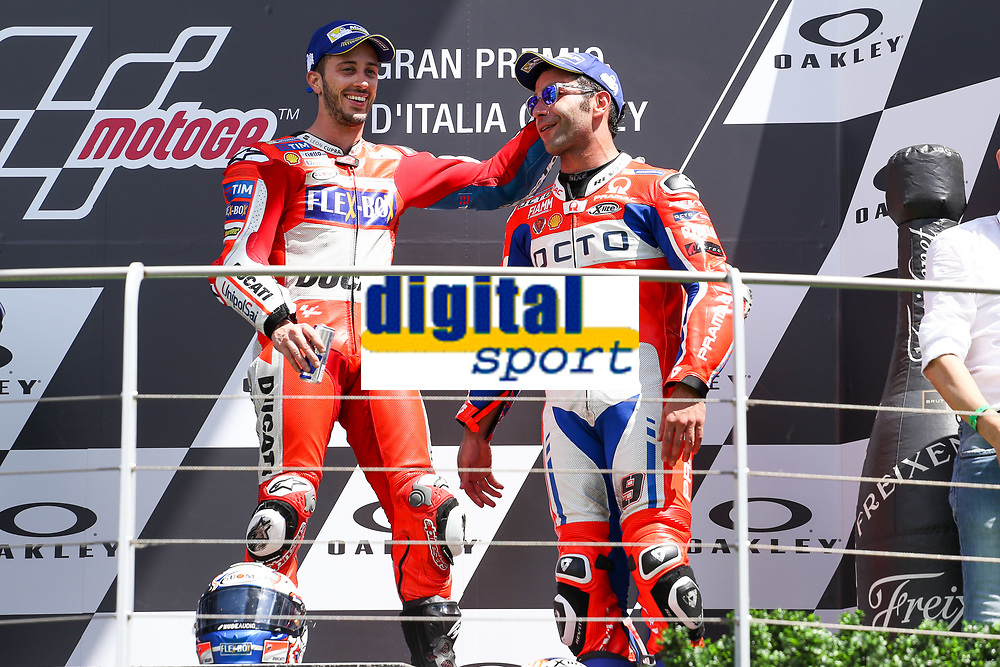 Ducati's Team rider Italian Andrea Dovizioso, winner, Danilo Petrucci of Italy and OCTO Pramac Racing third during the Moto GP Grand Prix at the Mugello race track on June 4, 2017 celebrates on the podium. <br /> MotoGP Italy Grand Prix 2017 at Autodromo del Mugello, Florence, Italy on 4th June 2017. <br /> Photo by Danilo D'Auria.<br /> <br /> Danilo D'Auria/UK Sports Pics Ltd/Alterphotos