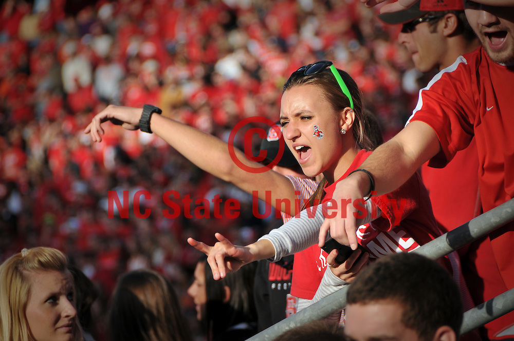 Students cheer on the Wolfpack as they enter Carter-Finley Stadium.