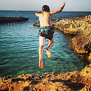 Ostuni 2015, child jumping into the sea.