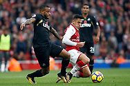 Luciano Narsingh of Swansea City (L) lunges into Alexis Sanchez of Arsenal (R). Premier league match, Arsenal v Swansea city at the Emirates Stadium in London on Saturday 28th October 2017.<br /> pic by Steffan Bowen, Andrew Orchard sports photography.