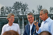 """12th Biennale of Architecture. Giardini. Austrian Pavillion Opening Ceremony. Group exhibition """"Austria Under Construction: Austrian Architecture Around the World; International Architecture in Austria"""". Commissioner Eric Owen Moss speaking; next to him Dr. Claudia Schmied, Austrian Federal Minister for Education, Arts and Culture; Dr. Heinz Fischer, President of Austria."""