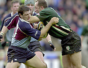 Photo - Peter Spurrier.25/01/03.Powergen Cup Quarter Final London Irish v Rotherham.Brendan Venter and Rimiro Pez.