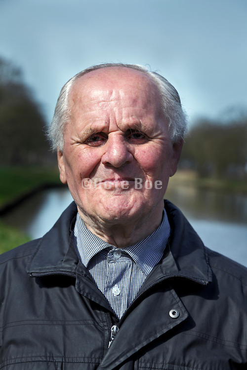 portrait of senior 88 year old man smiling   part of series taking out putting in dentures