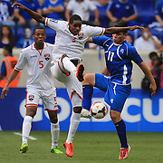 Joevin Jones, Trinidad and Tobago, challenges Rodolfo Zelaya, El Salvador, (right), during the El Salvador Vs Trinidad and Tobago CONCACAF Gold Cup group B football match at Red Bull Arena, Harrison, New Jersey. USA. 8th July 2013. Photo Tim Clayton