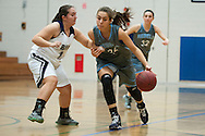 South Burlington's Elizabeth Khosravi (24) drives to the hoop past Burlington's Doireann Chesbrough (10) during the girls basketball game between the South Burlington Rebels and the Burlington Sea Horses at Burlington High School on Tuesday night Febraury 2, 2016 in Burlington. (BRIAN JENKINS/for the FREE PRESS)