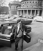 Dail Reassembles at Leinster House..1973..28.03.1973..03.28.1973..28th March 1973..After the recent general election The Dail resumed today at Leinster House,Dublin..Late for work! Mr John Bruton TD is pictured as hurries to get to the reassembly of the Dail in Leinster House.