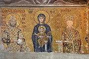 Detail of Deesis mosaic, 12th-13th century, showing Emperor John II Komnenos, Virgin Mary, Jesus Christ, and Empress Irene, Hagia Sophia, 532-37, by Isidore of Miletus and Anthemius of Tralles, Istanbul, Turkey. Hagia Sophia, The Church of the Holy Wisdom, has been a  Byzantine church and an Ottoman mosque and is now a museum. The current building, the third on the site, commissioned by Emperor Justinian I, is a very fine example of Byzantine architecture. The historical areas of the city were declared a UNESCO World Heritage Site in 1985. Picture by Manuel Cohen.