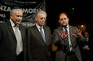 Roma, 16 Ottobre  2012.Commemorazione per le deportazioni degli ebrei dal ghetto di Roma del 16 ottobre 1943..Renzo Gattegna, Presidente unione Ebrei Italiani, Mario Monti, Presidente del Consiglio,Riccardo Pacifici, Presidente della Comunità Ebraica di Roma.Sixty-nine years later, Rome remembers October 16, 1943, when over a thousand Roman Jews, and among them 350 children, were driven from their homes. An official ceremony and candlelight vigil is organized by the Community of Sant'Egidio  and the Jewish Community in memory of the sacrifice Roman Jews rounded up by the Nazis in Rome.Renzo Gattegna , President of the Union of Italian Jewish Communities ,the prime minister Mario Monti and Riccardo Pacifici, president of the Jewish community in Rome.