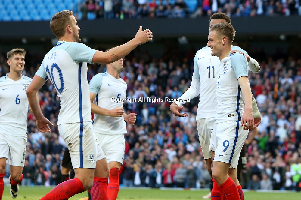22.05.2016. Etihad Stadium, Manchester, England. International football friendly match, England versus Turkey. Goalscorer Jamie Vardy is congratulated by Harry Kane