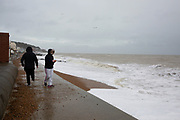 Brave walkers pass along the pedestrian walkway in Sandgate near Folkestone, Kent on the south coast of England,  Monday February 10, 2020, as Storm Ciara continues to sweep over the United Kingdom. Amber weather warnings were put into place by the MET office as gusts of up to 90mph and heavy rain swept across the UK. An amber warning from the MET office expects a powerful storm that will disrupt air, rail and sea links travel, cancel sports events, cut electrical power and damage property.  (photo by Andrew Aitchison / In pictures via Getty Images)