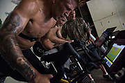 June 7, 2017 / Yorba Linda, Calif.<br /> <br /> Strength and conditioning coach Sam Calavitta monitors all of his athletes bodily functions from carbon dioxide output to metabolic rate to heart rate to gauge their recovery time and performance abilities. While pedaling on a stationary bike, TJ Dillashaw, left, and Aaron Pico, center, are closely monitored by Coach &quot;Cal,&quot; far right. (Melissa Lyttle for ESPN)