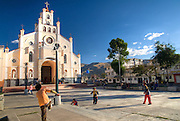 Kids play soccer in the church square.  Huaráz lies at an altitude of 3,052 m, approx. 420 km north of Lima.  It sits in the agriculturally important Callejón de Huaylas valley, at the foot of the Cordillera Blanca mountain range, which includes Huascarán, the highest mountain in Peru at 6,768 m.  Nikon D200, 17-50/2.8.